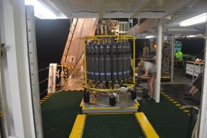 CABIOS intern collects water samples from the CTD