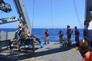scientists on the research vessel Atlantic Explorer deploy pumps off the stern