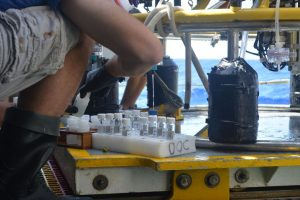 scientist samples dissolved organic carbon from CTD samples